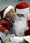 Foto Kind beim Weihnachtsmann